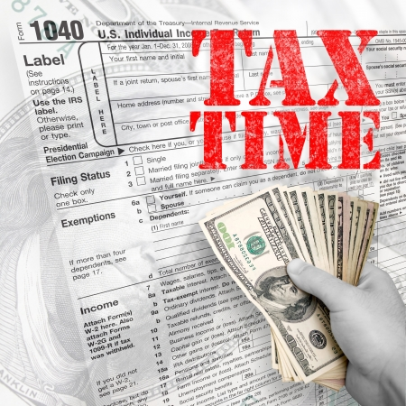 A tax time themed montage for US taxpayers with a hand full of money fanned out. photo