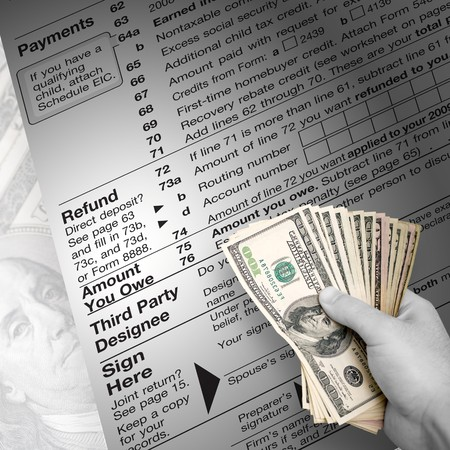 refund: A tax time themed montage for US taxpayers with a hand full of money fanned out. Stock Photo