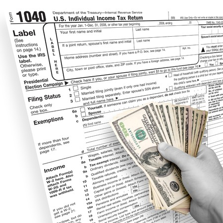 taxpayers: A tax time themed montage for US taxpayers with a hand full of money fanned out. Stock Photo