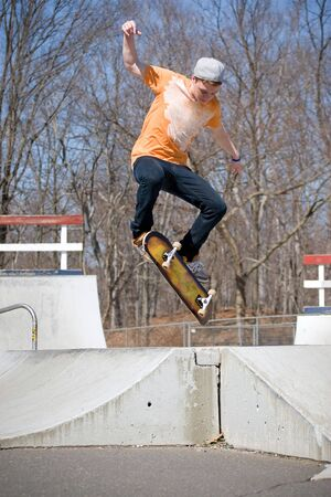 Portrait of a young skateboarder performing a jump at the skate park. Stock Photo - 4652342