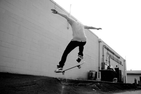 A young skateboarder doing a stunt in an urban area. photo