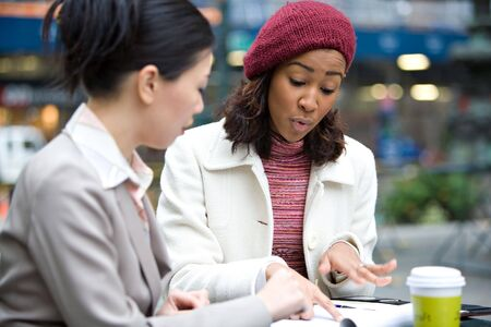 Two business women having a casual meeting or discussion in the city. Shallow depth of field. Stock Photo - 4652349