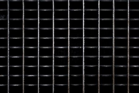 metal grate: A metal subway grate texture that is worn and weathered.