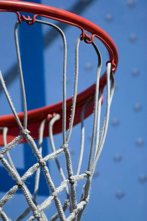 Closeup detail of a playground basketball goal and net.  Shallow depth of field. Stock Photo - 4684125