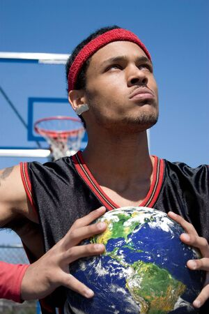 A young basketball player gripping the earth tightly. photo