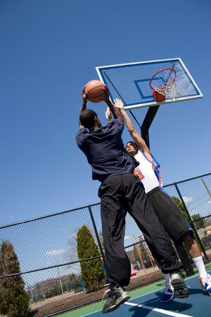 A young basketball player going for a jump shot. Stock Photo - 4717278