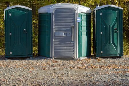 private public: Some portable toilets located on the wooded hiking trail.