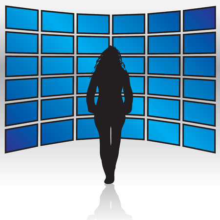 A woman standing in front of a wall of widescreen LCD or plasma TV screens. Ilustração