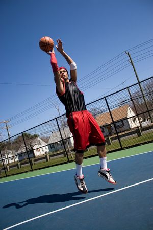 baller: A young basketball player shooting a three point jump shot.