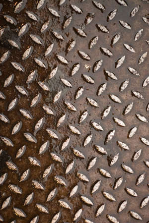Closeup of real diamond plate material.  Wet and rusty.  This is a photo not an illustration. Stock Illustration - 4822223