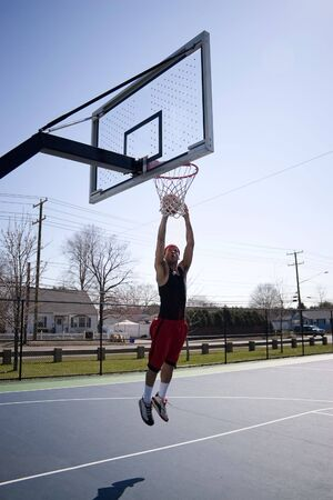 A young basketball player driving to the hoop. photo