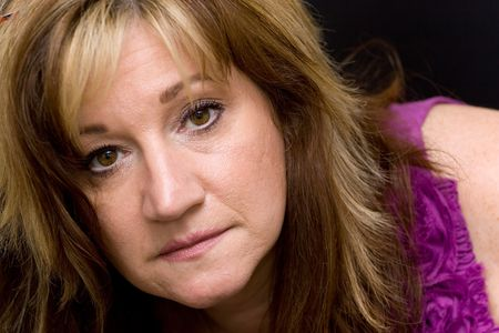 Portrait of a serious looking middle aged woman. photo
