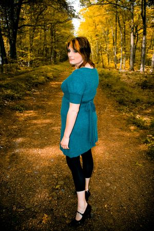 A young woman posing on a wooded path. photo