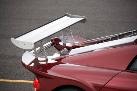 Closeup detail of a custom racing spoiler on the rear of a sports car. photo