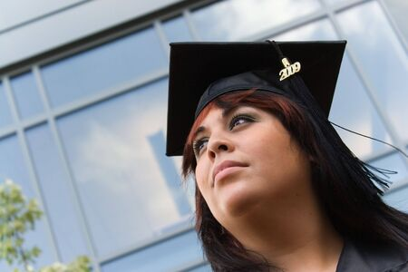 A recent graduate thinks about what she will do now that she has completed her education. photo
