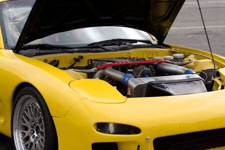 A closeup of a modern sports car with the hood popped open. Stock Photo - 5201725