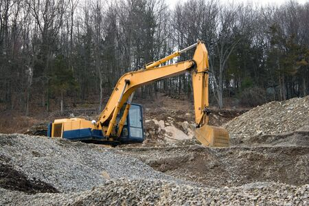 View of a construction site with heavy duty equipment. photo