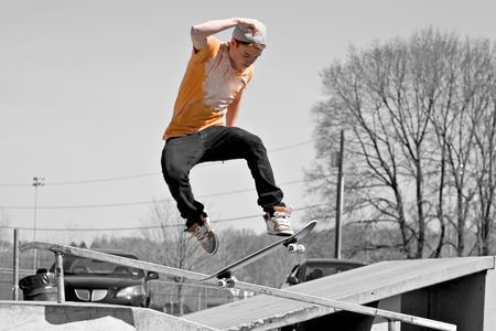 Portrait of a young skateboarder skating on a ramp at the skate park. photo