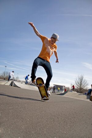 A young skateboarder doing a stunt in a skate park. photo