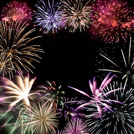 Beautiful fireworks exploding over a dark night sky with copy space in the center. Stock Photo - 5271689