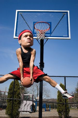 baller: A basketball player with a large head driving to the hoop with some fancy moves. Stock Photo