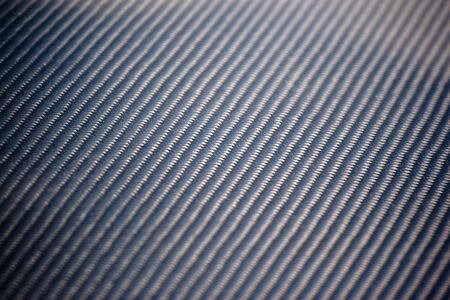A closeup of real carbon fiber material.  This makes an excellent texture or background.  Shallow depth of field. photo