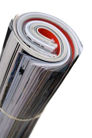 Rolled up magazines isolated over white. Shallow depth of field.   photo