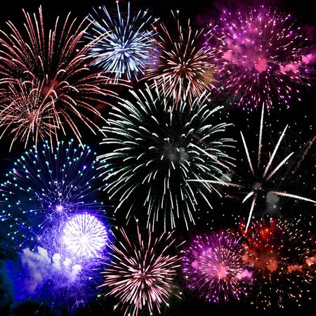 Beautiful fireworks exploding over a dark night sky in a grand finale display.  Very high resolution. Stock Photo - 5317821