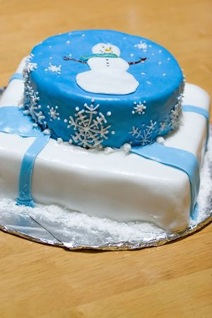 A cake with fondant icing featuring a winter design. photo