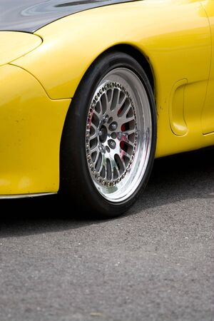 A closeup of the custom rims on a modern sports car with plenty of copyspace. Stock Photo - 5355200