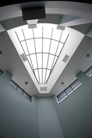 architectural interior: A modern architectural interior with a triangular shaped skylight.