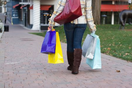 An attractive girl out shopping in the city. Stock Photo - 5343595