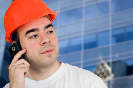 A construction worker talking on a cell phone with copyspace photo