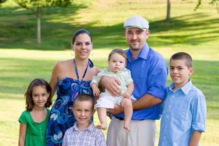 Portrait of an attractive young family with four children. Stock Photo - 5428161