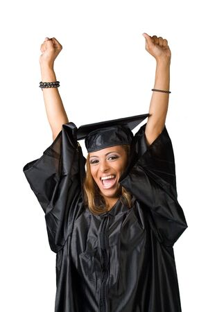 fondo de graduacion: Un graduado reciente posando en su toga y birrete aislados en blanco. Clipping path included. Foto de archivo