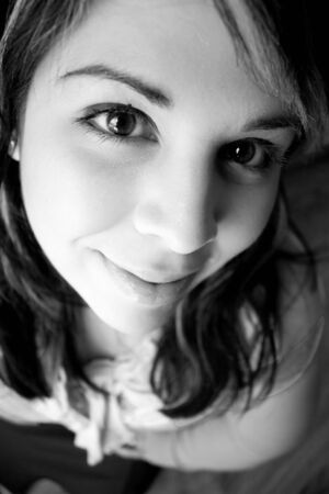 Portrait of an attractive young woman extremely close up in black and white.  Shallow depth of field. photo