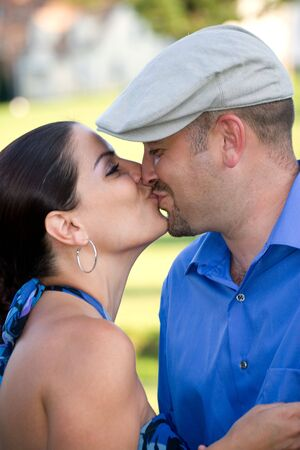 A young couple kissing each other on the lips. photo