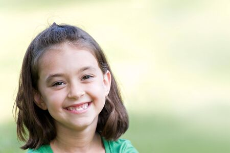 A cute little girl smiling happily with copyspace. photo