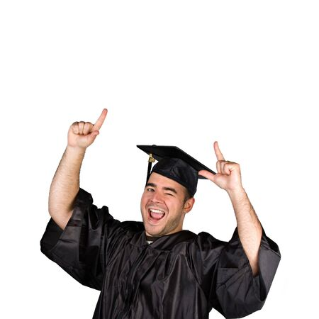 A recent graduate posing in his cap and gown isolated over a white background. photo