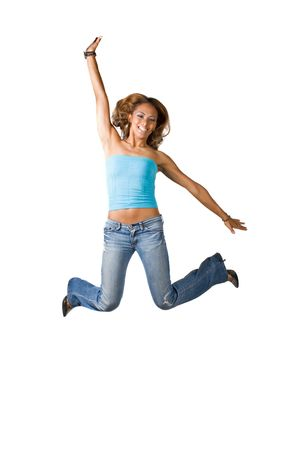 A young woman jumping and having fun.  Isolated over  a white background. Stock Photo - 5555555