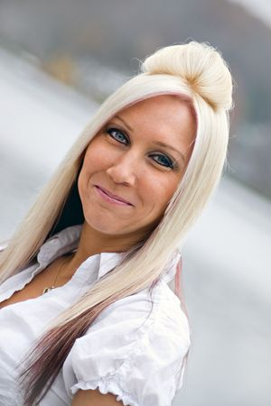 A closeup of a pretty blonde woman that is smiling. Stock Photo - 5596798