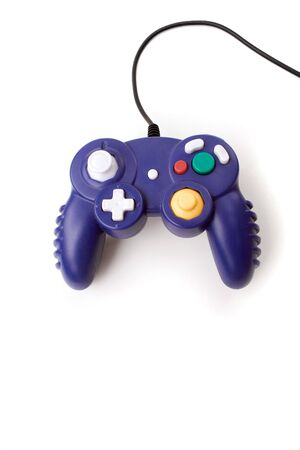 A video game controller game pad isolated over white. photo