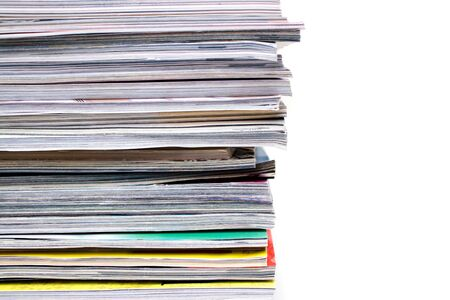 mag: A large stack of magazines piled high.  Isolated over white with copyspace. Stock Photo