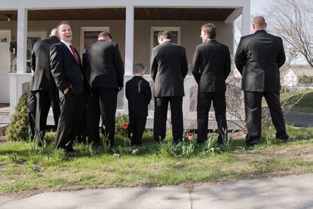 best party: The groomsmen and other male members of a bridal party peeing in the bushes while the groom laughs.