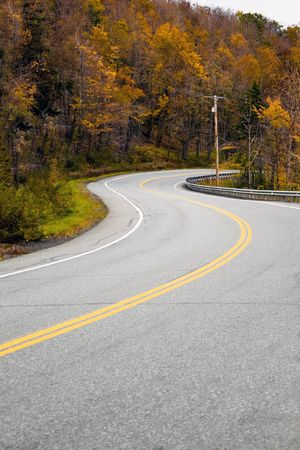 A curved New England road during the fall with bright foliage. photo