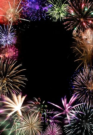 Beautiful fireworks exploding over a dark night sky with copy space in the center.  Works great as a greeting card or ad layout. Stock Photo - 5860423