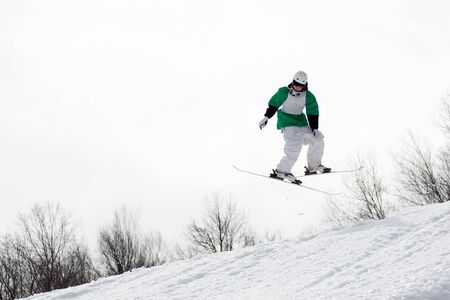 reverse: A freestyle skier catching some major air after launching off of a jump in reverse.
