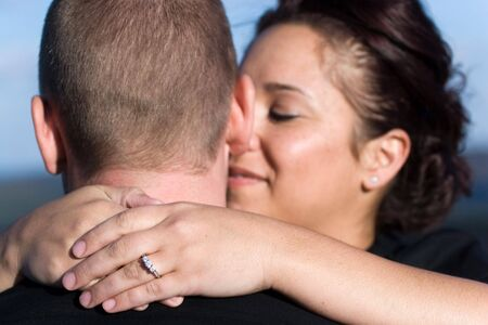 A young happy couple that just got engaged.  Shallow depth of field with focus on the diamond engagement ring. Stock Photo - 5879499