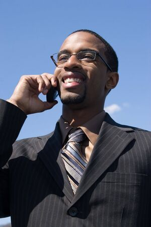 A young business professional talking on his wireless mobile phone. photo