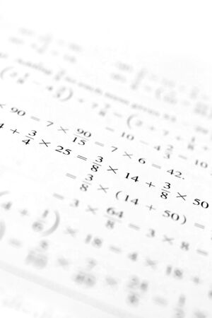 multiplying: Macro shot of some algebraic math problems.  Shallow depth of field. Stock Photo